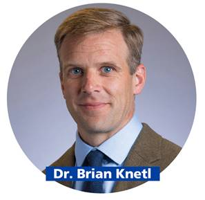 Picture of smiling man with short blond hair with name Brian Knetl