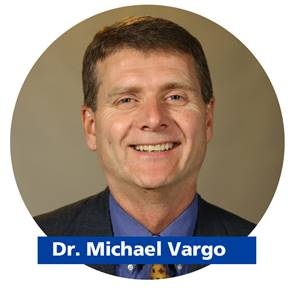 Picture of grinning man with brown hair and name Michael Vargo